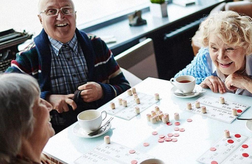 Older people playing bingo
