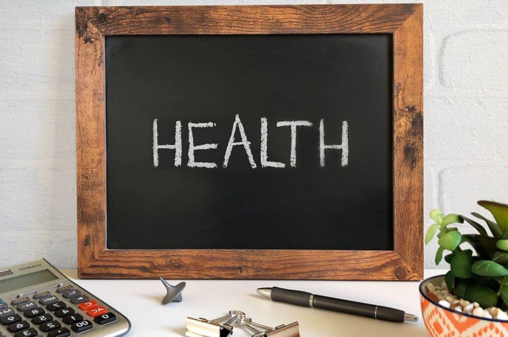 Board with inscription Health