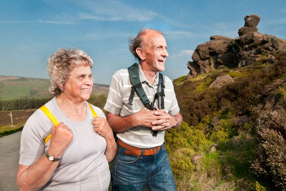 Two elderly people with backpacks